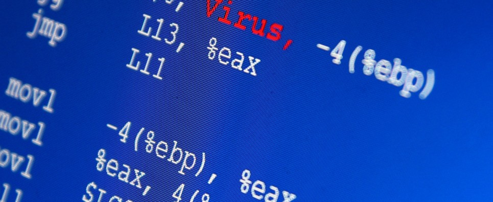 Code in Assembler programming script with a red Word VIRUS